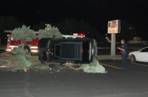 Aurora cops in inspect the rollover accident