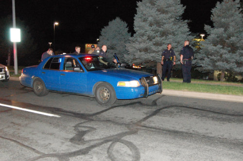 APD Cops hold suspect behind this blue police car - photo by Shane Anthony AuroraNews1.com
