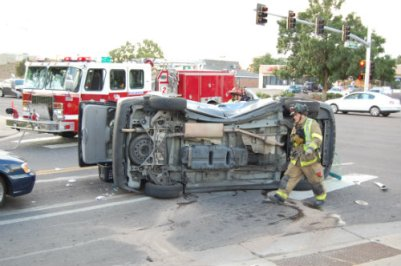 Firefighter walks by rollover