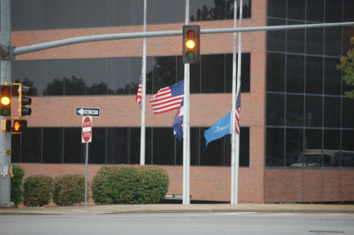 Flags fly at Half-Staff today 9/11/14 - Photo by Shane Anthony AuroraNews1.com