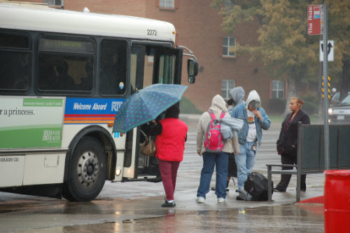 Folks shake off chilly damp weather today 9/11/14 - Photo by Shane Anthony AuroraNews1.com