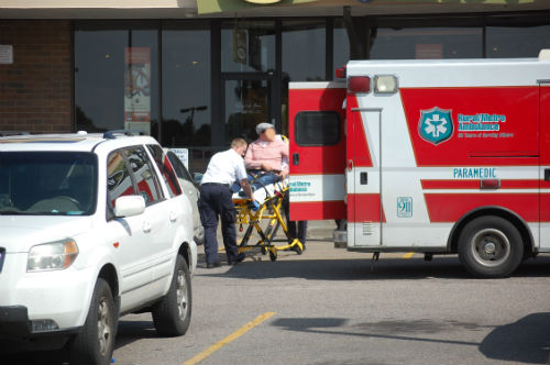 Baseball bat assault victim is loaded into an ambulance - Photo by Shane Anthony AuroraNews1.com