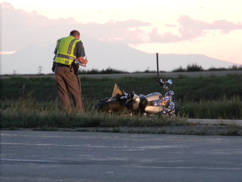 CSP trooper inspects fatal motorcycle crash on I-70 - photo by Shane Anthony AuroraNews1.com