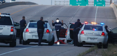 Aurora cops hold 4 drive-by shooting suspects at gun-point.  Photo by Shane Anthony AuroraNews1.com
