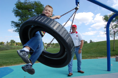 Tire swing fun on a picture-perfect waning summer day - Photo by Shane Anthony AuroraNews1.com