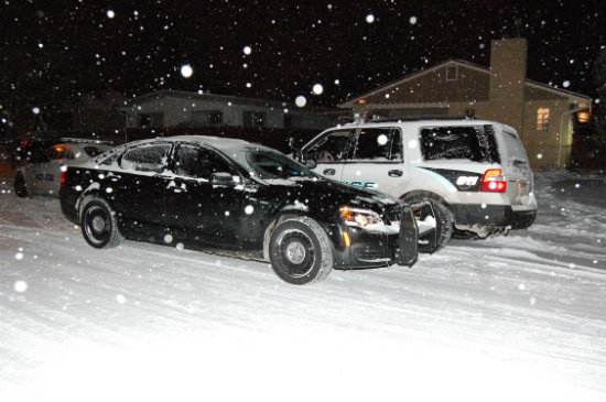 Aurora Cops investigate footprints in the snow nearby.  Photo by Shane Anthony AuroraNews1.com