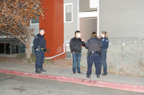 Cops stand outside of the scene of the DEA bust located on E. Tennessee Ave.  Photo by Shane Anthony AuroraNews1.com