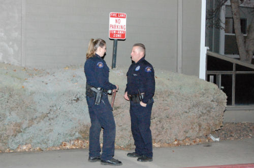 An Aurora K-9 officer speaks to another cop at the scene of the DEA bust.  Photo by Shane Anthony AuroraNews1.com