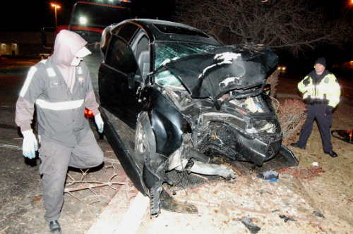 This car struck a tree killing the female driver and sending 3 males to local hospitals.  Exclusive Photo by Shane Anthony AuroraNews1.com