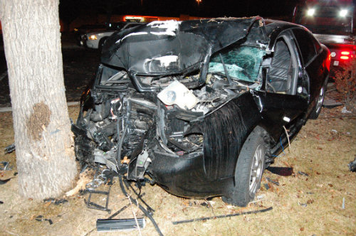 Shown here is the black Audi sedan which Desja Manuel was driving the night that she died.  Exclusive photo by Shane Anthony AuroraNews1.com Copyright 2014