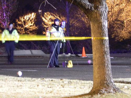 Aurora traffic investigators survey the fatal crash scene on 12/18/14. Photo by Shane Anthony AuroraNews1.com