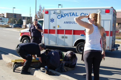 EMS personnel treat the auto-pedestrian victim Photo by Shane Anthony AuroraNews1.com