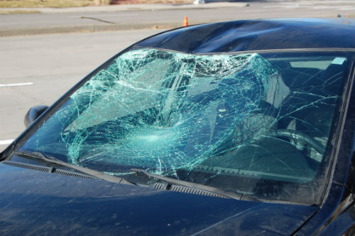Severe damage to the windshield of the car which struck the pedestrian implies serious injury to the pedestrian.  Photo by Shane Anthony AuroraNews1.com