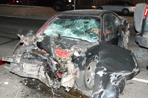 A crashed stolen car sits at Chambers and Mexico.  Exclusive photo by Shane Anthony AuroraNews1.com