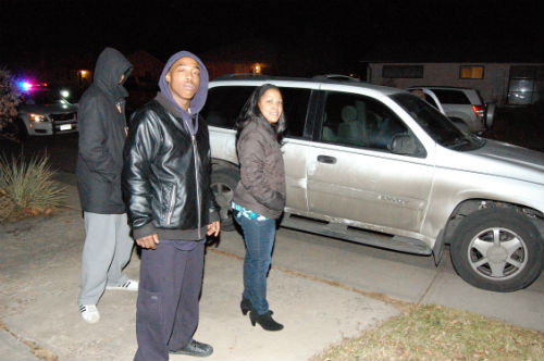 The Denver family who's SUV was stolen poses with their recovered car.  Photo by Shane Anthony AuroraNews1.com