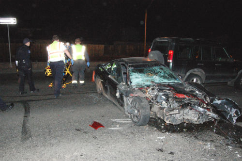 A car theft suspect is taken to an ambulance after the huge crash.  Exclusive photo by Shane Anthony AuroraNews1.com