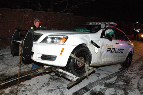 2 Aurora cop cars get bashed on icy Aurora roads.  Photo by Shane Anthony AuroraNews1.com