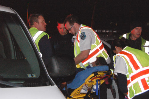 A stolen car crash suspect is removed by paramedics from a cop car.  Exclusive photo by Shane Anthony AuroraNews1.com