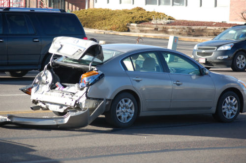This car sustained heavy rear-end damage as a result of this afternoon's crash.  Photo by Shane Anthony AuroraNews1.com