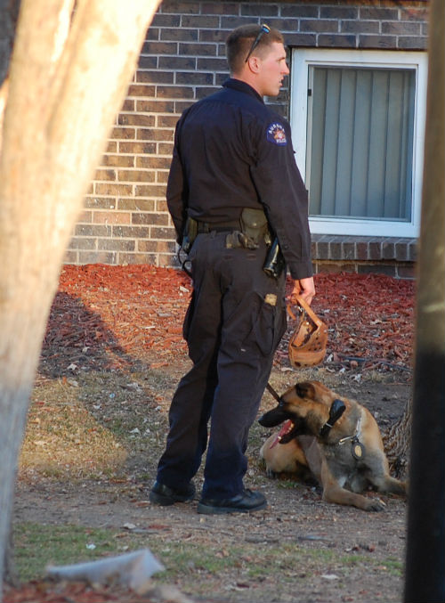 A K-9 cop stands by the arrest scene today 01/27/15.  Exclusive Photo by Shane Anthony AuroraNews1.com