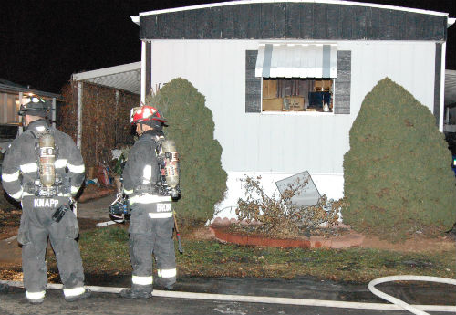 An overnight fire on E. Buchanan Place sent 1 woman to the hospital on 01/27/15.  Photo by Shane Anthony AuroraNews1.com