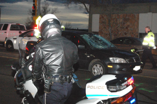 An Aurora PD motorcycle cop parks in front of the serious auto vs. pedestrian accident at 1st. and Havana. Photo by Shane Anthony AuroraNews1.com