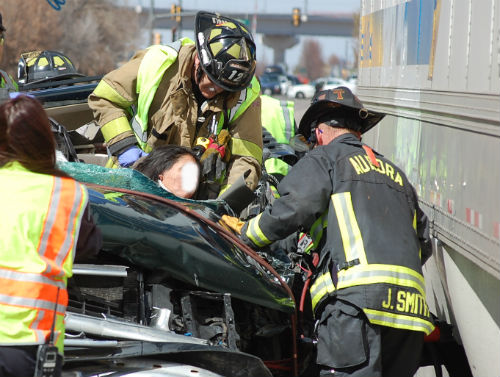 A woman is trapped in this crash at 24th and Airport.  Photo by Shane Anthony AuroraNews1.com