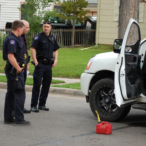 Aurora cops examine the bizarre attack scene.  Photo by Shane Anthony AuroraNews1.com