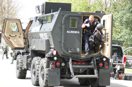 An Aurora cop exits the BEAR armored vehicle.  Exclusive photo by Shane Anthony AuroraNews1.com